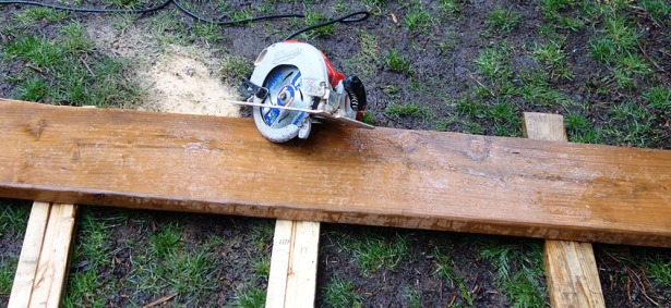 Use a skill saw to cut boards in half